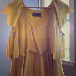 Karen Zambos yellow feather blouse